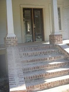Love the brick steps and Antique doors.