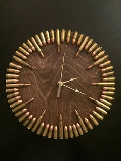 READY TO SHIP! Bullet Clock with inert ammo. Great gift for shooters, hunters, military, man cave, gun gift! Bullet Clock with inert ammo. Great gift for shooters.Call today or stop by for a tour of our facility! Table Design Bois, Wood Design, Wooden Wall Decor, Wooden Walls, Man Cave Wall Decor, Man Cave Art, Man Cave Clocks, Man Cave Room, Car Man Cave