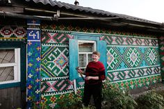 Bottle Cap House  Posted by Lauren on September 20th, 2012  Olga Kostina has turned her modest home, in the rural town of Kamarchaga in the Siberian taiga, into quite the landmark. Inspired by traditional macrame motifs, the Russian pensioner has individually nailed over 30,000 plastic bottle caps to create pixelated patterns. She's vowed to continue adding more bottle caps until every wall is completely covered