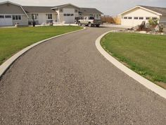 Broom finish concrete ribbons lining a gravel driveway