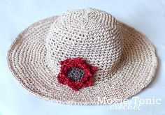 Ravelry: Shady Dahlia Straw Sun Hat pattern by Natalie Gowen    Aweosme raffia sun hat - perfect for our southern hemisphere summer!