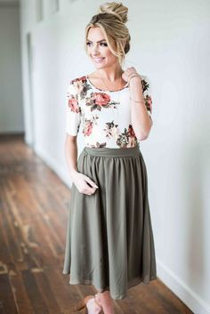 Pleated skirt and floral blouse for spring.