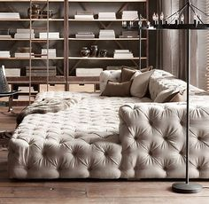 "Must build a sofa like this. Start with a wood platform and back/arm frame, then use a mattress for the base, foam cushions, and upholstery? I might actually build a wood ""sofa bed"" frame, add some rustic carvings and dark stain, and leave it exposed rather than upholster the whole couch."