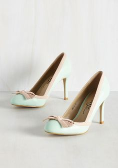 Following a stellar performance review, you strut through the office in these pastel pumps. The cadence these vegan faux-leather heels create bolsters your uplifted attitude, while their taupe, felt-like trim and bow-topped toes carry you confidently across the workplace.