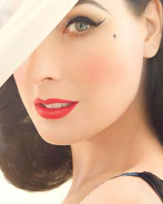 Dita Von Teese- Perfect long cat eye with lashes (always wear lashes) and a great red lip. NO GLOSS! Do you have a beauty mark... highlight it.