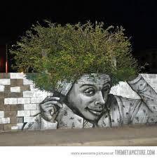 grafitti showing man combing bush