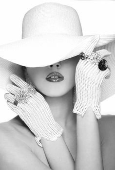 components for timeless fashion photography: a young woman's partially obscured face, hat, gloves and sparkling jewellery in black and white