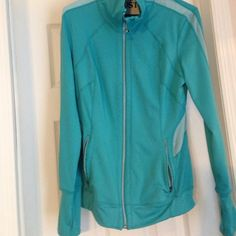 Zip up workout top Aqua color with a lighter blue mesh detail. Thumb holes, zipper front, and zip pockets. Used only once or twice. Smoke free home. Tangerine Tops Sweatshirts & Hoodies