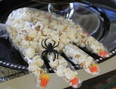 Popcorn Witch's Hand These are perfect little Halloween party favors! Fill a non-latex glove with popcorn and something in each finger to resemble the nails (raisins, candy corn, almonds), tie off the end, and maybe even accessorize with a plastic spider ring. Easy and fun!