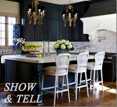 Dark blue cabinets. Marble island and back splash. Butcher block counters. Brass chandeliers over island. Bar stools and lighting from Aidian Gray. Photo via Cote de Texas.