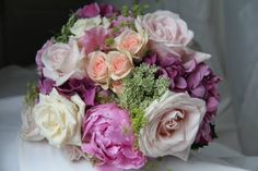 English Garden Wedding Bouquet: roses, peonies, sweet peans in shades of pinks, lavender and coral