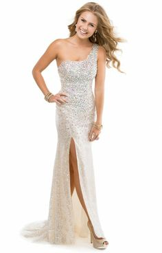 Ow, OW! This Flirt P9858 dress is fantastic! This dress has an amazingly beaded strap on the left shoulder and a slit up the right side of the dress! The bodice of this dress has crystal beading and sparkling sequins. This dress is prom ready!