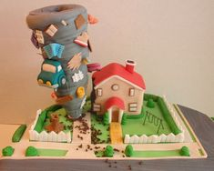 Tornado damaging a house cake.JPG