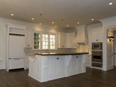 These look like 9 foot ceilings to me i like the cabinet for Kitchen cabinets 8 foot ceiling