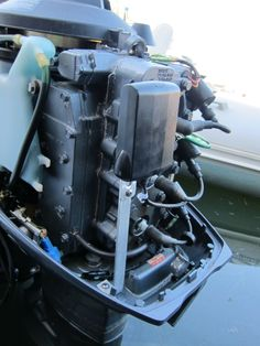 An outboard motor installation with a custom mounting bracket.  Sample Siren Marine device installation images.  For more support, visit our website: http://sirenmarine.com/support/