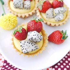 Fruit tarts topped with strawberries and dragon fruit