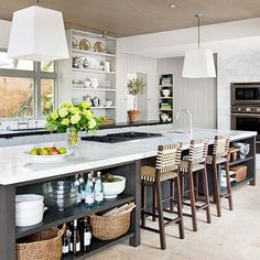 "Love incorporating bookshelves and seating space in the huge island, central in the kitchen for ""breakfast space"""