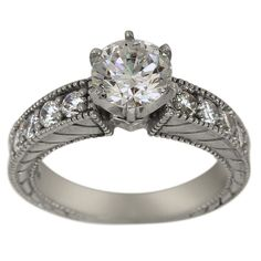Antique Large Diamond Accented Engagement Setting For Any Center -  This engagement ring can accommodate any size and shape center diamond.     This versatile ring is adorned with brilliant round diamonds which enhance the center diamond.   The engraving and the milgrain give this ring the pronounced appearance of antique rings.       The settings for our rings are made in our Florida factory using the finest gold and G-H color, SI clarity conflict-free diamonds. Dacarli has been...
