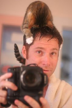 There's a cat on my head IMG_5582 by -Andrew-, via Flickr