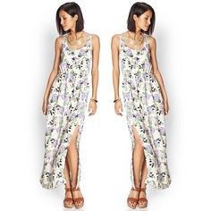 Forever 21 Rose Floral Maxi Dress Gorgeous rose print maxi dress from Forever 21. Gotta love those strappy shoulder straps! Lined half way down the skirt. Long side slit so it's easy to walk in! Worn once. Excellent pre-loved condition. Say hello to summertime!! ☀️🌸 👉NO TRADES👈 Forever 21 Dresses Maxi