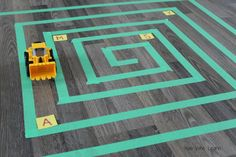 Make a maze out of painters tape and learn letters - running, diggers, and mazes?  This idea is awesome!!  Such a great way for preschoolers to learn the alphabet