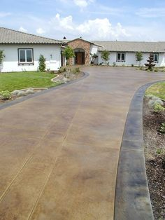 i like the colors, the border and the stamped/engraved lines in the driveway - Scored, Coffee Concrete Driveways Surfacing Solutions Temecula, CA