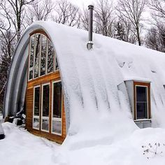 The Quonset style huts are able to withstand HUGE snow loads with the right gauge of steel.