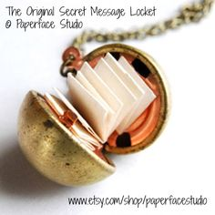 Original Secret Message Locket by   Marcella (Artist. Santa Fe, New Mexico) aka Paperface Studio via Etsy. Vintage brass ball 'secret message' locket with three strips of accordion folded parchment paper so you can write a wish or a secret or a message ... 24.00 USD ... Cool piece of jewelry! Create your own little book -pfb :-)