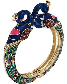 Add a touch of quirky-chic to your look with this striking peacock bracelet from Betsey Johnson. Crafted in antiqued gold-tone mixed metal, the hinged design is embellished with glass crystal accents.