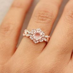 This beautiful white gold light pink/ peach Morganite ring is simply gorgeous. With a unique pear shape cut Morganite, the is a center gem has a weight of carats and is surrounded by a total of carats of diamonds. Shop Engagement Rings, Engagement Ring Settings, Vintage Engagement Rings, Diamond Engagement Rings, Bridal Rings, Wedding Rings, Gold Diamond Wedding Band, Ring Verlobung, Unique Rings