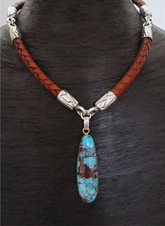 I just made this leather and Bisbee Turquoise necklace for a client of mine.  I love the combination of elements in this piece....the beautifully made New Mexico leather, the blue American Bisbee Turquoise and the combination of sterling silver and 22k gold.