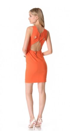 TALI CROSS BACK DRESS $271.88 SPECIAL $40.78 YOU SAVE: 85% A sleeveless, jersey alice + olivia dress with crisscross straps over the sexy open back. Exposed back zips. Mesh lining.
