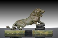 "1930.fr - Stunning art deco lion by Rochard - A very hard to find metal lion on marble base. Signed Rochard. Excellent condition. Wonderful patina. Lions are very uncommon in art deco sculptures world. Circa 1930 70cm x 18cm x 38cm  27.5"" x 7"" x 15"""