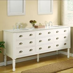 The vanity cabinet's pearl white finish is designed with clean, crisp lines and insets in the doors. Three functional drawers are built with dove-tailed drawer joinery, flanked by two single hinged doors with faux drawer fronts.