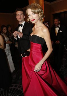 Singer Taylor Swift arrives with her brother Austin Swift during a cocktail reception before the 71st annual Golden Globe Awards in Beverly Hills, California on Jan. 12, 2014.