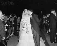 23 May 1953, Manhattan, New York, New York, USA — New York: Kennedy's Daughter Get's Bridal Kiss.. Robert Sargent Shriver, Jr., of Chicago, is shown kissing his bride, the former Eunice Mary Kennedy, daughter of Joseph P. Kennedy, former U. S. Ambassador to England, and Mrs. Kennedy, after their marriage in St. Patrick's Cathedral today. The bride's father gave her away and the marriage ceremony was performed by Francis Cardinal Spellman. — Image by © Bettmann/CORBIS
