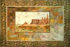 """Monument Valley Mesa  44 x 64    This quilt was one of the pieces documenting the many trips our family has taken throughout the Southwest, camping, hiking and exploring. I have always loved the receding border designed by Angela Madden in her book """"Pieceful Scenes"""" and used her directions along with my Electric Quilt software to design this piece. I incorporated yarns and beads to bring the scene to life. I also used Shiva Paintstiks to add texture and dimension to the mesas."""