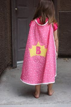 Super Hero Cape...I made 12 of these babies out of round dollar store table cloths and masking tape.  Personalized with foam crowns and gems taped to the back.  Very easy and fun!