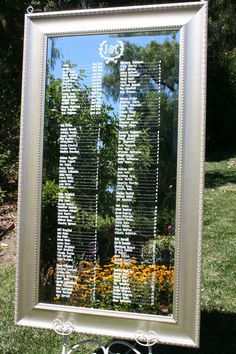 Large mirrored seating chart for 144 guests. Olive wreath monogram detail