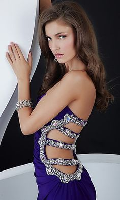 Floor length one shoulder prom dress. Cut out detailed back.