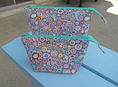 I saw a tablet computer bag a couple of years ago that had a tab on both ends. I've wanted to make one ever since.       T...
