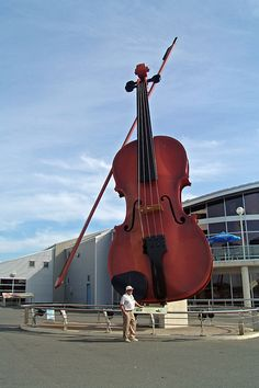World's Biggest Violin - If you want to gawk at this huge violin you're going to have to make a visit to the east coast of Canada. Over in Cape Breton, Nova Scotia is where you will find it but something tells me it really isn't worth the visit Ouvrages D'art, Cape Breton, Roadside Attractions, Water Tower, World's Biggest, Outdoor Art, Canada Travel, Nova Scotia, Art Plastique