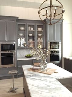 Absolutely stunning kitchen! Love the rich dark cabinet color and that marble! Drooling! from design indulgence