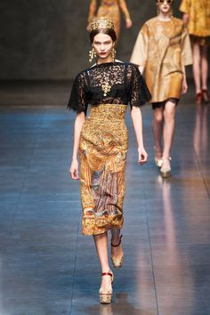 Love the lace blouse tucked into a high-waisted skirt at Dolce & Gabbana Fall 2013 runway #fashionweek