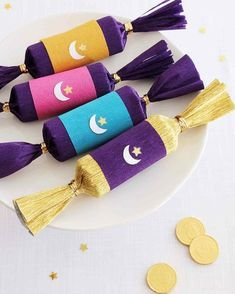 Want a sweet ending to your Eid al-Fitr feast? Children and adults alike will love breaking open these festive paper crackers -- each one is filled with tiny treats including candy coins, date balls, and nougat.
