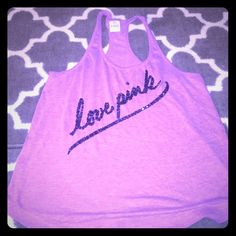 PINK size S light purple racerback No signs of wear or tear. Pet and smoke free home. Light purplish color. Says love pink in black sequins. Other PINK gear in closet. Feel free to bundle or offer. PINK Victoria's Secret Tops Tank Tops