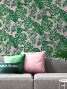 This Skinnydip Dominica Tropical Leaf Wallpaper is a perfect on-trend tropical print to bring style to any room. The design features a stunning pattern of palm leaves and cheese plant leaves in various tones of green, set on a soft blush pink matte background. Easy to apply by pasting the wall, this high quality paper would look great when used to create a feature wall or to decorate a whole room.