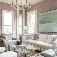 lavender grasscloth living room | landscape oil on linen art by karen smidth | linen pillows by megan adams brooks | antique glass and burl coffee table | blue agate lamps | chandlier | blue print | blueprintstore.com