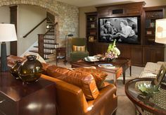 basement family room - camel and olive green color scheme