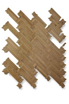 """Re-thinking traditional wood floor, where rounded, bevelled and curved boards along with a slight """"bombé"""" effect of the surface create a new language. The smooth cut of the boards allows to play with new designs and compositions, which although similar to the classic patterns of ancient wood floors, give life to modern and original herringbone, …"""